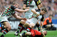 Sam Smith of Harlequins is tackled by David Strettle of Saracens during the Aviva Premiership match between Saracens and Harlequins at Wembley Stadium on Saturday 31st March 2012 (Photo by Rob Munro)