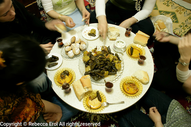 Eating at the communal Turkish sofra table, Istanbul, Turkey