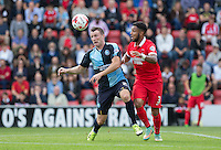 Garry Thompson of Wycombe Wanderers & Frazer Shaw of Leyton Orient battle for the ball during the Sky Bet League 2 match between Leyton Orient and Wycombe Wanderers at the Matchroom Stadium, London, England on 19 September 2015. Photo by Andy Rowland.