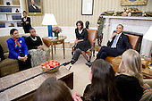 United States President Barack Obama and first lady Michelle Obama meet with mothers in the Oval Office to promote the president's health care law in the White House, December 18, 2013 in Washington, DC. The Wednesday's meeting focused on ways the law can benefit families. <br /> Credit: Olivier Douliery / Pool via CNP