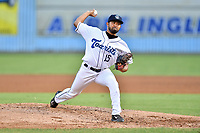 Asheville Tourists starting pitcher Rico Garcia (15) delivers a pitch during a game against the Greenville Drive at McCormick Field on September 5, 2017 in Asheville, North Carolina. The Tourists defeated the Drive 4-2. (Tony Farlow/Four Seam Images)