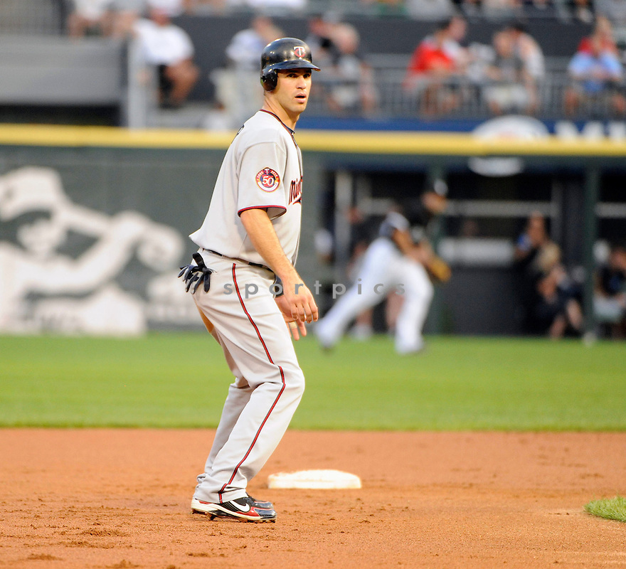 JOE MAUER, of the Minnesota Twins, in action during the Twins  game against the Chicago White Sox  at US Cellular Field in Chicago, IL on August 10, 2010.  The Twins won the game 12-6...