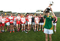 XXJOB 18-11-2015: To the Victor the Spolis!...Patrick Darcy, captain, St. Brendan's College, Killarney lifts the cup watched by the vanquished Pobalscoil Chorca Dhuibhne after St. Brendan's College won the Munster u-15 footbal final in Killarney on wednesday.<br /> Picture by Don MacMonagle
