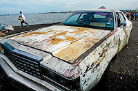 A rusty American classic car from 1970s, used as a shared taxi, seen parked on the bank of the lake Maracaibo in Maracaibo, Venezuela, 9 May 2006.
