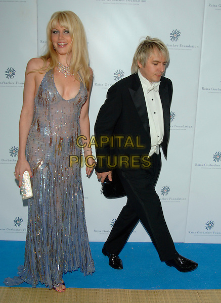 MEREDITH OSTROM & NICK RHODES.Raisa Gorbachev Foundation Launch Party, Althrop, Northamptonshire, England,.10th June 2006..full length silver grey sequined beaded dress sheer couple ostrum knickers underwear.Ref: PL.www.capitalpictures.com.sales@capitalpictures.com.©Capital Pictures