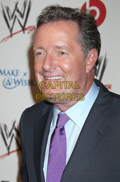 Piers Morgan<br /> WWE &amp; E! Entertainment's &quot;SuperStars For Hope&quot; supporting Make-A-Wish at The Beverly Hills Hotel in Beverly Hills, CA., USA.<br /> August 15th, 2013<br /> headshot portrait black suit purple tie blue shirt grey gray<br /> CAP/ADM/RE<br /> &copy;Russ Elliot/AdMedia/Capital Pictures