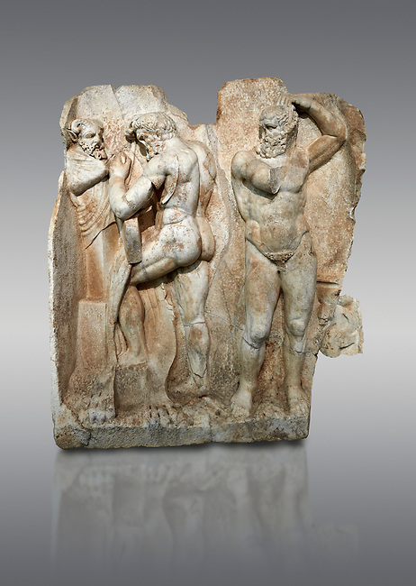Roman Sebasteion relief sculpture of  Herakles is preparing to wrestle the Libyan giant Antaios. Aphrodisias Museum, Aphrodisias, Turkey.<br /> <br /> Herakles (left) is taking off his bow case to hang it on a pillar statue. Antaios (right) is binding up his head with ear protectors, next to him stands an oil basin used in the palaistra (wrestling ground). Antaios was a famous wrestler who challenged and killed all visitors to his country, until he was defeated by Herakles.