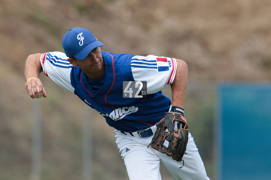 24 july 2010: Robin Allemand of France throws the ball to first base during Netherlands 10-0 victory over France, in day 2 of the 2010 European Championship Seniors, in Neuenburg, Germany.