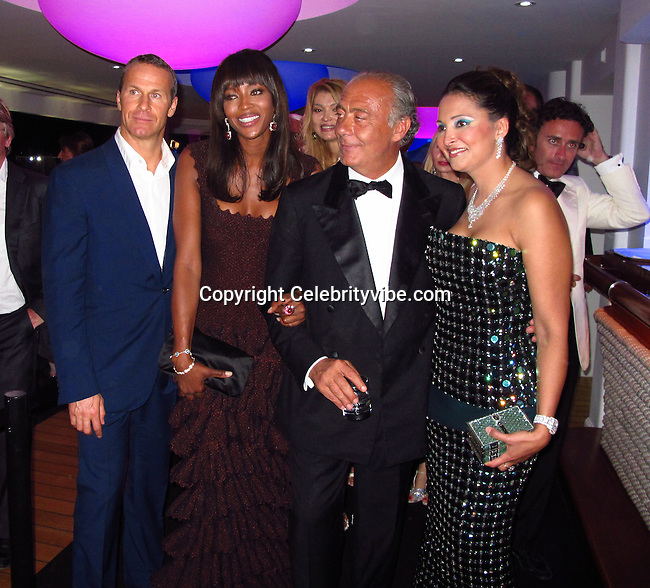 Vladimir Doronin, Naomi Campbell and Founder and President of De Grisogono Fawaz Gruosi..De Grisogno Party..2011 Cannes Film Festival..Eden Roc Restaurant at Hotel Du Cap..Cap D'Antibes, France..Tuesday, May 17, 2011..Photo By CelebrityVibe.com..To license this image please call (212) 410 5354; or.Email: CelebrityVibe@gmail.com ;.website: www.CelebrityVibe.com