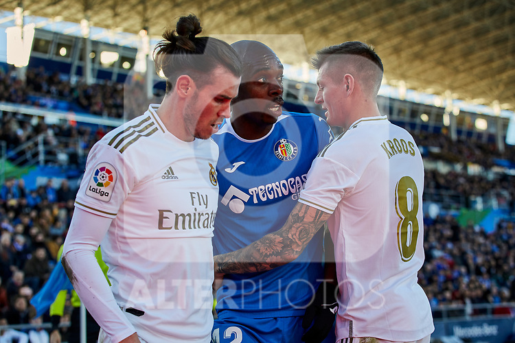 Allan-Romeo Nyom of Getafe FC and Gareth Bale (L) and Toni Kroos (R) of Real Madrid during La Liga match between Getafe CF and Real Madrid at Coliseum Alfonso Perez in Getafe, Spain. January 04, 2020. (ALTERPHOTOS/A. Perez Meca)