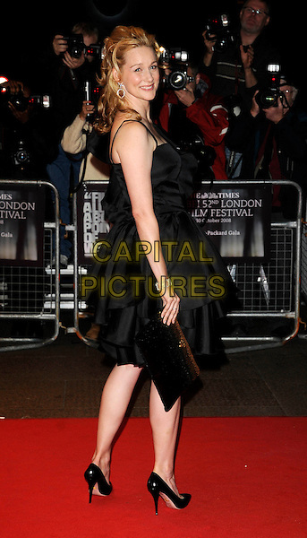 "LAURA LINNEY .""The Other Man"" Premiere during The Times BFF London Film Festival, odeon Leicester Square, London, England, UK, .October 17th 2008..red carpet full length black dress shoes layers looking back over shoulder .CAP/CAN.©Can Nguyen/Capital Pictures"