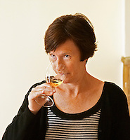 Britt Karlsson, BKWine.com, tasting a glass of Chateau Bouscaut in the tasting room  Chateau Bouscaut Cru Classe Cadaujac  Graves Pessac Leognan  Bordeaux Gironde Aquitaine France