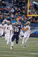 Annapolis, MD - December 28, 2015:     Navy Midshipmen wide receiver Thomas Wilson (89) fights for the ball with Pittsburgh Panthers defensive back Avonte Maddox (14)during the Military Bowl game between Pitt vs Navy at Navy-Marine Corps Memorial Stadium in Annapolis, MD. (Photo by Elliott Brown/Media Images International)