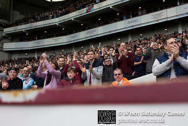 West Ham United 2 Crystal Palace 2, 02/04/2016. Boleyn Ground, Premier League. Home fans in theBetway Stand applauding their team during the first-half at the Boleyn Ground as West Ham United hosted Crystal Palace in a Barclays Premier League match. The Boleyn Ground at Upton Park was the club's home ground from 1904 until the end of the 2015-16 season when they moved into the Olympic Stadium, built for the 2012 London games, at nearby Stratford. The match ended in a 2-2 draw, watched by a near-capacity crowd of 34,857. Photo by Colin McPherson.