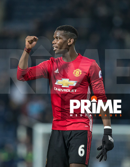 Paul Pogba of Manchester United celebrates the win during the EPL - Premier League match between West Bromwich Albion and Manchester United at The Hawthorns, West Bromwich, England on 17 December 2016. Photo by Andy Rowland / PRiME Media Images.