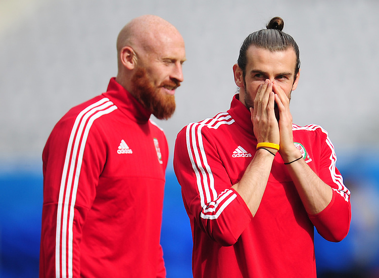 Wales's Gareth Bale shares a joke with James Collins during todays training session<br /> <br /> Photographer Kevin Barnes/CameraSport<br /> <br /> International Football - 2016 UEFA European Championship - Training Session - Group B - England v Wales - Wednesday, 15th June 2016 - Stade Bollaert-Delelis, Lens Agglo, France<br /> <br /> World Copyright &copy; 2016 CameraSport. All rights reserved. 43 Linden Ave. Countesthorpe. Leicester. England. LE8 5PG - Tel: +44 (0) 116 277 4147 - admin@camerasport.com - www.camerasport.com
