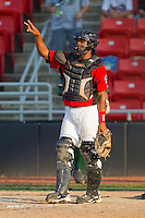 Catcher Leonel De Los Santos #2 of the Hickory Crawdads lets his defense know there are two outs against the Greensboro Grasshoppers at  L.P. Frans Stadium July 10, 2010, in Hickory, North Carolina.  Photo by Brian Westerholt / Four Seam Images