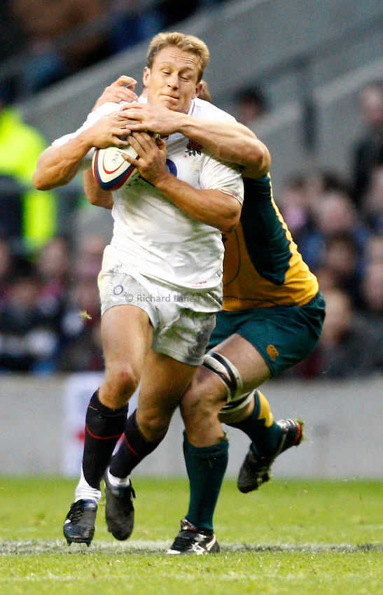 Photo: Richard Lane/Richard Lane Photography. England v Australia. Cook Cup. Investec Challenge Series 2009. 07/11/2009. England's Jonny Wilkinson is tackled.