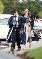 Felipe Viera and Olivia Perigo arrive at CC for the commencement ceremony.
