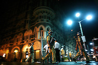A police team in front of the Taj Mahal Palace Hotel after multiple terrorist attacks were launched in Mumbai on 26/11/2008..