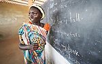 A woman stands by the blackboard in an English class in the Arrupe Learning Center, run by Jesuit Refugee Service in Bunj, South Sudan. Participants come from four refugee camps in Maban County that together shelter more than 130,000 refugees from the Blue Nile region of Sudan, along with local residents from the host community.<br /> <br /> Misean Cara provides support for the work of Jesuit Refugee Service in Maban.