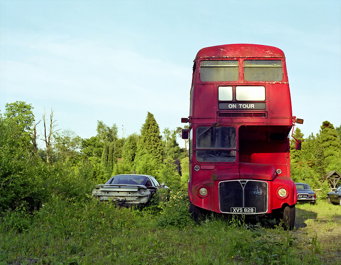 An abandoned Routemaster bus - 'On Tour' - sits in a Sussex field.