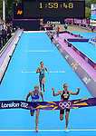 LONDON, ENGLAND - AUGUST 4:  Gold medalist Nicola Spirig of Switzerland and Silver medalist Lisa Norden of Sweden sprint to a photo finish as Erin Densham of Australia trails for the bronze during the Women's Triathlon Final, Day 8 of the London 2012 Olympic Games on August 4, 2012 at the Hyde Park in London, England. (Photo by Donald Miralle)