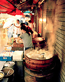 CHINA, Hangzhou, woman cooking steam buns at an outdoor market