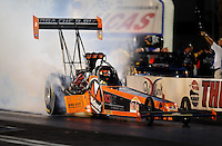 Oct. 31, 2008; Las Vegas, NV, USA: NHRA top fuel dragster driver Urs Erbacher does a burnout during qualifying for the Las Vegas Nationals at The Strip in Las Vegas. Mandatory Credit: Mark J. Rebilas-
