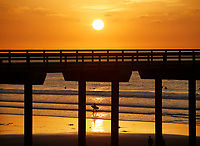 December 23, 2018 - San Diego, California, USA - A surfer walks out of the water at sunset during a low tide at La Jolla Shores Beach.   (Photo Credit: © K.C. ALFRED/ZUMA PRESS)