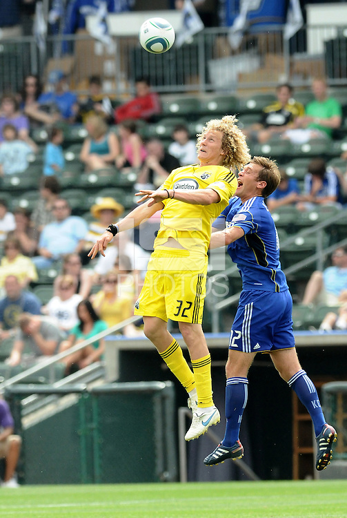 Steven Lenhart (yellow), Jimmy Conrad...Kansas City Wizards were defeated 1-0 by Columbus Crew at Community America Ballpark, Kansas City, Kansas.