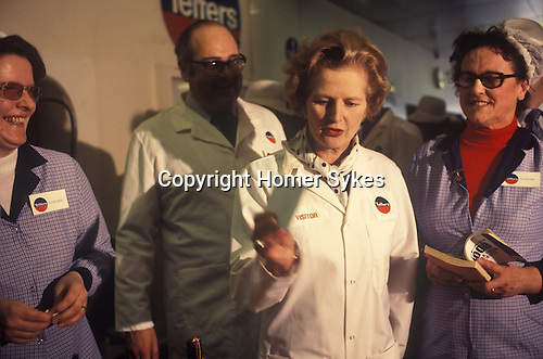 Maggie Thatcher on factory visit to Telfers Northampton during the 1978 February 24th  General Election campaign England. UK she is drawing a lottery ticket.<br />