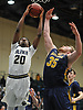 Tre Riggins #20 of Baldwin, left, drives to the net as Connor Payne #35 of Massapequa tries to contest his shot during the Nassau County varsity boys basketball Class AA semifinals at Farmingdale State College on Monday, Feb. 26, 2018. Baldwin won by a score of 50-41.