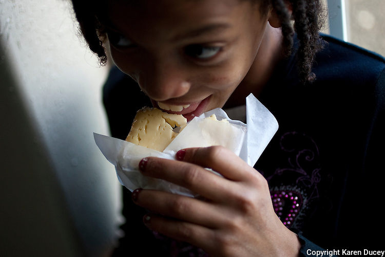 Faith Estrella, 11, takes a bite out of one the speciality cheeses at the Estrella Family Creamery in Montesano,Wash.  on November 4, 2010.  The Food and Drug Administration ordered the Estrella Family Creamery in Montesano,Wash.  to stop processing cheeses after it found listeria bacteria on some of the cheeses this year.  The family says they have made many renovations on the farm and the bacteria is only found on the soft cheese, not everything.  They believe they should be allowed to resume making cheese and sell the hard cheeses they have already made at the facility.  The creamery is one of Washington's most famous artisan cheesemakers.  (photo credit Karen Ducey). .