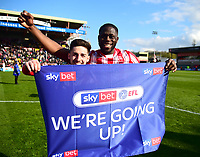Lincoln City's Tom Pett, left, and John Akinde celebrate promotion at the end of the game<br /> <br /> Photographer Andrew Vaughan/CameraSport<br /> <br /> The EFL Sky Bet League Two - Lincoln City v Cheltenham Town - Saturday 13th April 2019 - Sincil Bank - Lincoln<br /> <br /> World Copyright © 2019 CameraSport. All rights reserved. 43 Linden Ave. Countesthorpe. Leicester. England. LE8 5PG - Tel: +44 (0) 116 277 4147 - admin@camerasport.com - www.camerasport.com