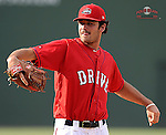Pitcher Cody Kukuk (25) of the Greenville Drive works on a pitcher fielding drill during the team's preseason workout one day before Opening Day on Wednesday, April 2, 2014, at Fluor Field at the West End in Greenville, South Carolina. (Tom Priddy/Four Seam Images)