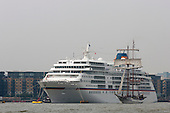 London, UK. 6 September 2014. Tall ship JR Tolkien passes the cruise liner Europa. Tall Ships sailing on the River Thames on the second day of the Royal Greenwich Tall Ships Festival 2014.