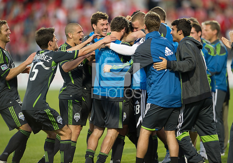 Seattle Sounders FC players celebrate the game winning goal by Seattle Sounders FC forward Fredy Montero #17 during an MLS game between the Seattle Sounders FC and the Toronto FC at BMO Field in Toronto on June 18, 2011..The Seattle Sounders FC won 1-0.