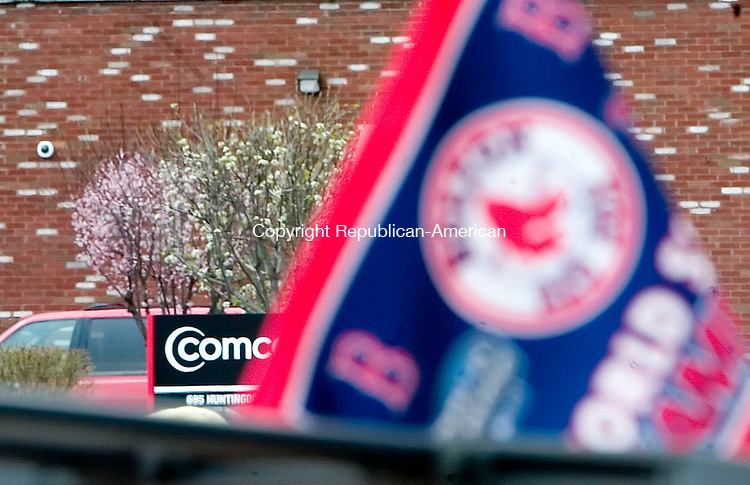 WATERBURY, CT- 28 APRIL 07- 042807JT04-<br /> The sign in front of the ComCast office on Huntingdon Avenue in Waterbury is eclipsed by a Boston Red Sox flag as fans gathered to sign a petition requesting ComCast to add New England Sports Network to its cable lineup on Saturday on Ford Avenue.<br /> Josalee Thrift Republican-American