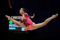 Simona Peycheva of Bulgaria split leaps to toss with rope at 2006 Mie World Cup Finale of rhythmic gymnastics on November17, 2006 at Mie, Japan.