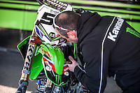 Kawasaki mechanic at Spanish Motocross Championship at Albaida circuit (Spain), 22-23 February 2014
