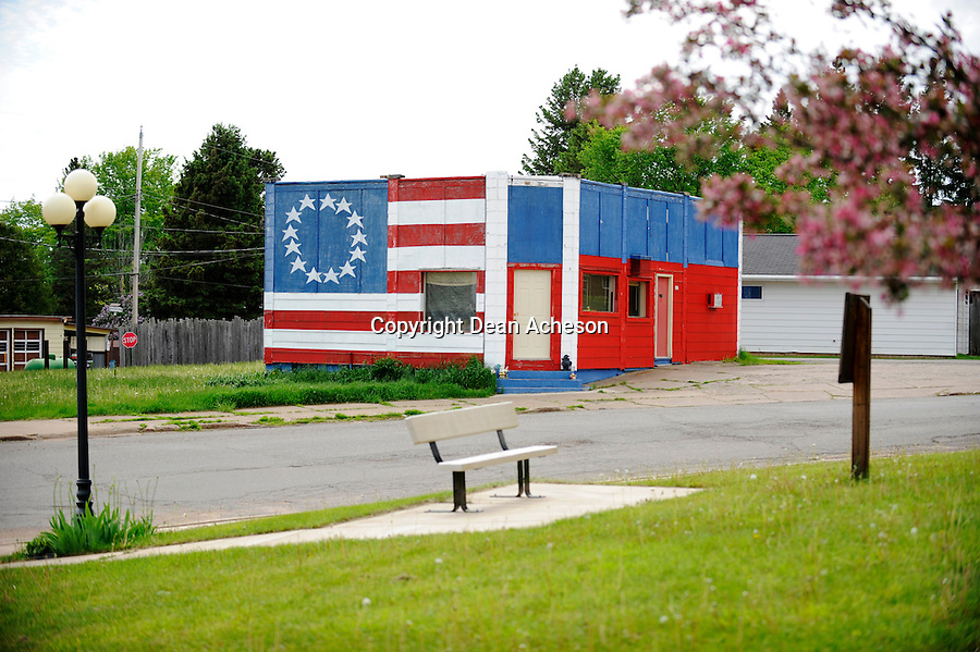 A building in Alpha, Mich. painted with the stars and stripes and matching colors. Alpha is a small hamlet in the Upper Peninsula of Michigan.