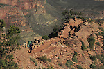 Woman backpacking down the South Kaibab Trail at Cedar Ridge to Phantom Ranch and the Colorado River, Grand Canyon, northern Arizona, USA .  John leads hiking and photo tours throughout Colorado. . John offers private photo tours in Grand Canyon National Park and throughout Arizona, Utah and Colorado. Year-round.