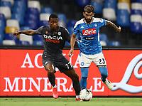 19th July 2020; Stadio San Paolo, Naples, Campania, Italy; Serie A Football, Napoli versus Udinese; Elseid Hysaj of Napoli holds off Marvin Zeegelaar Udinese Calcio