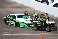 Feb 22, 2015; Chandler, AZ, USA; Crew members tow NHRA pro stock driver Deric Kramer during the Carquest Nationals at Wild Horse Pass Motorsports Park. Mandatory Credit: Mark J. Rebilas-