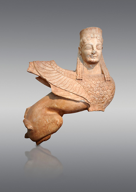 Pentelic marble Ancient Greek Archaic statue of a Sphnix from Spata, Attica. Circa 570 BC , Athens National Archaeological Museum. Cat no 28. Against grey.<br /> <br /> One of the earliest known Archaic Sphinx statues once a grave stele