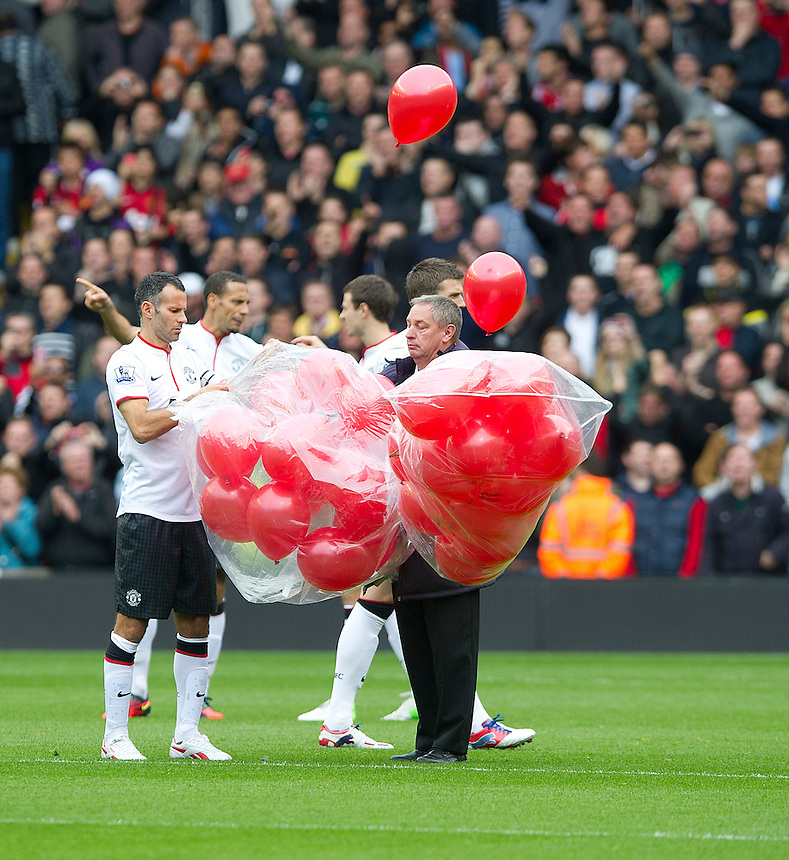 Manchester United's Ryan Giggs releases 96 red ballons, in memory of  the ninetysix who died in the 1989 Hillsborough disaster..Football - Barclays Premiership - Liverpool v Manchester United - Sunday 23rd September 2012 - Anfield - Liverpool..