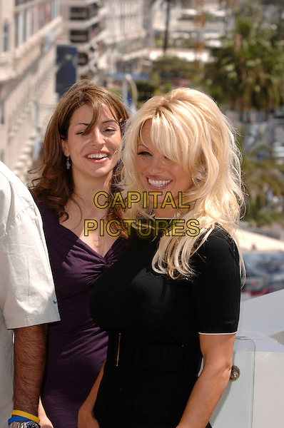 "EMMANUELLE VAUGIER & PAMELA ANDERSON .photocall for ""Blonde and Blonder"" .60th International Cannes Film Festival.Cannes, France 18th May 2007.half length purple dress black top belt.CAP/PL.©Phil Loftus/Capital Pictures"