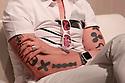 A detail view of designer Karim Rashid hands and tattoos as he attends the PepsiCo Mix It Up Round Table Talk at the  Fuorisalone Zona Tortona on April 15, 2016, in Milan, Italy.  &copy; Carlo Cerchioli<br /> <br /> Particolare delle mani e dei tatuaggi del designer Karim Rashid, in attesa della round table talk organizzata da PepsiCo Mix It Up in Fuorisalone Zona Tortona on April 15, 2016, in Milan, Italy.  &copy; Carlo Cerchioli