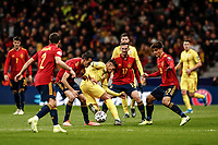 18th November 2019; Wanda Metropolitano Stadium, Madrid, Spain; European Championships 2020 Qualifier, Spain versus Romania;  Florinel Coman (Romania) challenges Sergio Busquets (esp) - Editorial Use